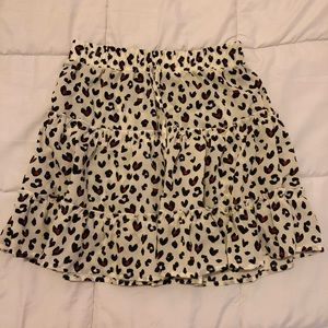 Ivory printed flared mini skirt